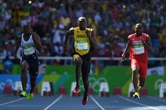 Jamaica's Usain Bolt cruises to win his heat.
