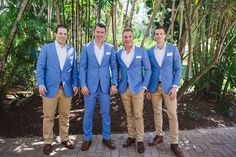 Handsome groom Matt and his groomsmen as they prepare for Matt's beautiful bride Lauren to walk down the aisle. We love the blue suits! Image by The White Tree Photography