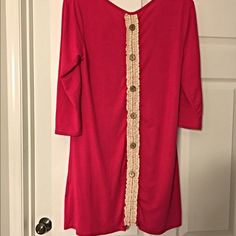 Gorgeous Hot Pink dress/tunic with crochet detail! So cute! 3 qtr sleeves in a soft knit material with a row of buttons and crochet on the back! Dresses