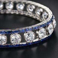 would be a great birthday present to me...diamond and sapphire bracelet perfection