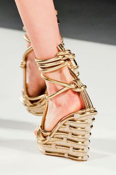 Moschino Spring 2012 - It looks like these would really hurt, but they are awfully cool!
