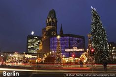 Lights streaks by the City Weihnachtsmarkt am Gedachtniskirche Christmas market on Ku'damm.