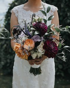 Eclectic bouquet featuring wine colored, peach, and lavendar colored florals // Lindsey Clawson Photography