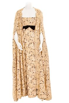 Metallic gold lace gown and cape in floral tape lace on net over browcn silk, ca. 1968, designed by Alfred Bosaud.
