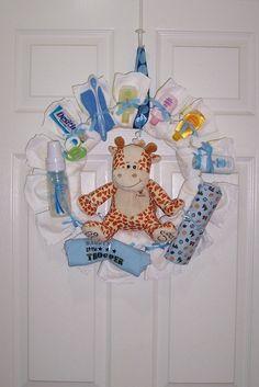 Cute diaper wreath includes baby items. Purchase at: www.bidc.biz