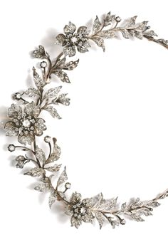 Diamond tiara, late 19th century. Designed as a foliate spray set with circular-cut and rose diamonds, the three flowers set en tremblent, fitted case, accompanied by three tiara frames, five hair pin fittings, four brooch pins and five original drawings depicting the various combinations for the jewels to be worn as a tiara, necklace, aigrette, brooches and corsage ornament.