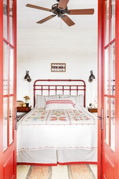 Pile On The Heirlooms:  Made by this East Alabama homeowner's grandmother, the hand-stitched quilt provided design inspiration for the entire guest room, starting with the red-orange paint on the French doors. The Laredo iron bed, another historically accurate touch, tempers the sweetness of the graphic floral motif.