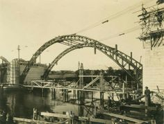 Steel spans have been lifted into place on the William Jolly Bridge (then known as the Grey Street Bridge),Brisbane in Queensland in 1931. •State Library of Queensland•