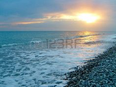panoramic beach: View of the sea in the evening at sunset on the Mediterranean sea. Stock Photo