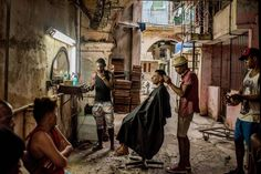 """Cuba on the Edge of Change' by Tomás Munita. Daily life, first prize stories. """"A weathered barber shop in Old Havana, Cuba."""""""
