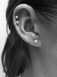 i like the idea of a double cartilage piercing :)