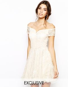 I love the bardot neckline of this short lace dress