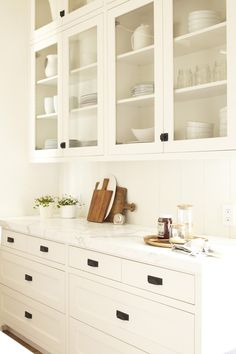 Rejuvenation Kitchen: our classic #hardware adds a finishing touch to pretty white cabinets