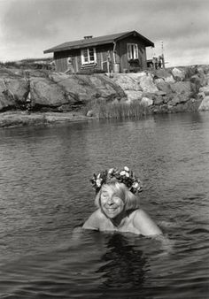 Tove Jansson swimming by her house in the Finnish archipelago.