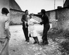 mujeres francesas colaboracionistas rapando pelo