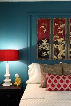 brown nightstands, white lamps to lighten the space up, white bedding, red accents (?)l-what about dark purple, navy blue