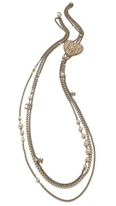 Rich imitation pearls give this flapper-inspired, authentic vintage Chanel necklace a hit of elegant appeal.