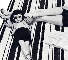 black and white photo of hip young girl. good housekeeping june 1952. vintage. retro. cat eye glasses. fashion. style.