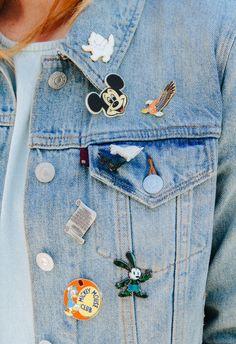 Disney pins on a jeans jacket