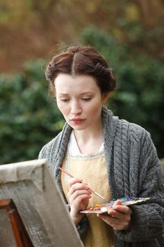 I love the almost Beatrix Potter feel of this picture. The up-do, the sweater, the somewhat cloudy feel, and the paint.