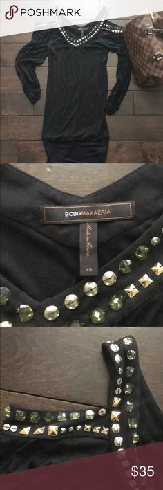 """BCBG Maxazria • Black shoulder cut our dress BCBG Maxazria • Black shoulder cut our dress.  Excellent condition.  Very detailed on neck and shoulders.  Fitted at bottom of dress.  Hits right above knee.  (I'm 5'5"""")  Size XS  ✨Reasonable offers welcome✨ BCBGMaxAzria Dresses Mini"""