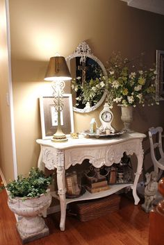 Romantic Entryway...love the chippy white urn and the soft wall color...lovely.