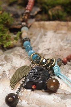 Buddha necklace with semi precious stones.