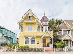 Here is a sweet Victorian yellow house named The Daffodil in Pacific Grove CA for sale with gingerbread details inside and on the exterior! Fans of Victorian homes will love this sweetheart of a home. Victorian Cottage, Victorian Homes, Modern Victorian, Victorian Dollhouse, White Exterior Houses, Storybook Cottage, Yellow Houses, Victorian Architecture, Stairs Architecture