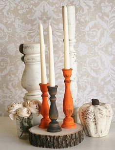 These rustic painted candlesticks would look great with an organic centerpiece, like a bowl of artichokes.