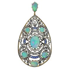 An absolutely fantastic diamond, opal, and sapphire pendant from the Art Nouveau (ca1910) era! The teardrop shaped pendant, which is particularly large in size, is made of 18kt yellow gold topped in sterling silver and is of French decent.