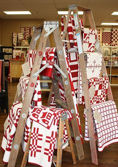 retail display of tablecloths | Ladders for quilts, blankets, knit blankets, lace tablecloths....