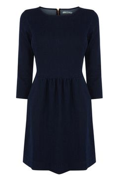 The denim dress gets an update for Autumn in a sultry dark indigo. Perfect with tights or bare legs!