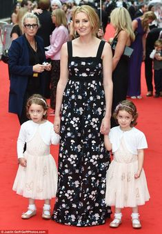 Cute: Laura, wearing an Erdem gown, was joined by the twin actresses who play her on-screen daughter Marigold