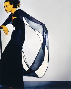 The final photograph of a Hubert de Givenchy model in [i]Vogue[/i], she strikes a dramatic pose in a gown from the designer's final collection (AW1995) for his eponymous house.