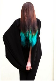 I'm completely entranced by this. It would be so fun to dye the ends of your hair-- doesn't it look like an aqua flame?-- and it could be easily tied up and hidden for work or other conservative functions... I'm in love. Found via A Slippery Maiden.
