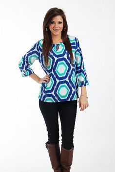 Pattern Shift Top, blue $39.00  You are sure to stand out thank to the gorgeous colors this top features! This one is super easy to throw on and features a key hold at the neck:)   Fits true to size. Miranda is wearing the small.