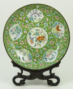 Antique Chinese Hand Painted Enamelled Round Plate, Circa Qing dynasty period, 19th century, Depicts various landscape scenes with chickens, birds, flowers, pagodas & butterflies.