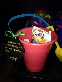 Take home sand pail and shovel as party favor for an under the sea themed birthday..includes goldfish,bubbles,water gun,fish shaped lollipop and sea creature tattoos!