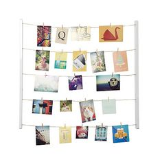 Show off those treasured memories in style with this forty clip hanging photo frame by Umbra. This wall mounted photo hanger adds plenty of character to any office, lounge or kitchen and comes complete with all the clips you need to make your favourite collages.