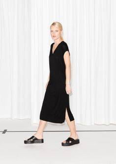 Soft and breathable viscose is crafted into this comfy, straight-fit dress that reaches a flattering midi-length.
