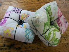 Pincushions made from a vintage piece of needlework and an old quilt