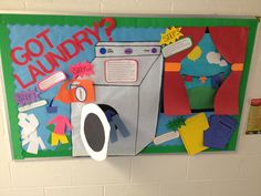 Laura Hauser helps her first year residents learn about doing laundry with her informative and decorative bulletin board.