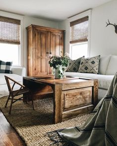 Farmhouse Tour - love the warm wood furniture and white walls