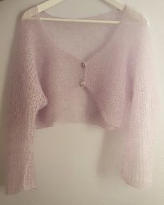 Hand knitted bolero / cardigan / capelet made by luxurious kid mohair and silk yarn. Impressive long sleeved bolero that can be worn day & night since except for special occasions as weddings, parties etc, can be matched with your jeans, shorts & casual skirts. Extremely soft in touch & feel, that you will wish to wear it every day. A garment that should enrich every womans gardrobe. Available in many fantastic colors.   Perfect brides & bridesmaids garment and gift ...