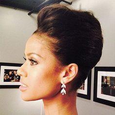 Gugu Mbatha voluminous, elegant french twist hairstyle