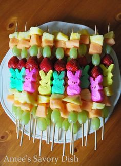 How to make kid-friendly fruit kabobs for Easter layering marshmallow Peeps and colorful fresh fruit. A great alternative to candy.