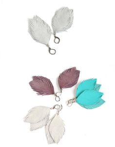 Leather or suede feather earrings in bright turquoise blue