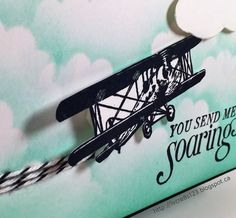 Linda Vich Creates: The Sky Really Is The Limit! A biplane soars across a cloud scudded, Pool Party sky, trailing Baker's Twine contrails in this long, narrow card.