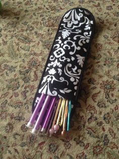 Thirty one flat iron case as a knitting needle carry case.