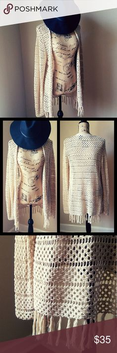 """""""Graceful Gathering""""- Fringed Open Knit Sweater Draped within this cozy cardi, you're ready to hit the sidewalk, shoreline, or soiree in effortless style! A breezy open knit, with a creamy vanilla hue, relaxed sillhouette, and swingy tasseled hemiline, adorns this peice with nomadic flare, and equips this lovable layer with a carefree attitude you'll employ on the reg.       🥀In Perfect Condition! Worn maybe twice.🥀 boutique Sweaters Cardigans"""